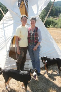 gina and kathy in front of tipi big